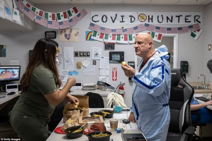 Dr Joseph Varon eats a meal in the nursing station in the COVID-19 intensive care unit during Thanksgiving at the United Memorial Medical Center in Houston, Texas yesterday