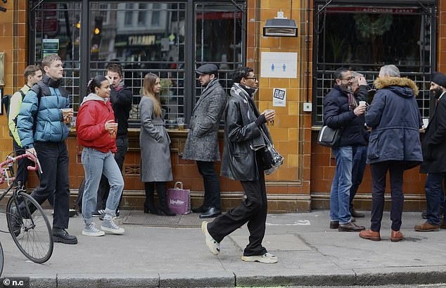Drinkers enjoy a pint in Borough Market today as it emerged drinkers in Tier 2 will have to leave the pub as soon as you finish your meal