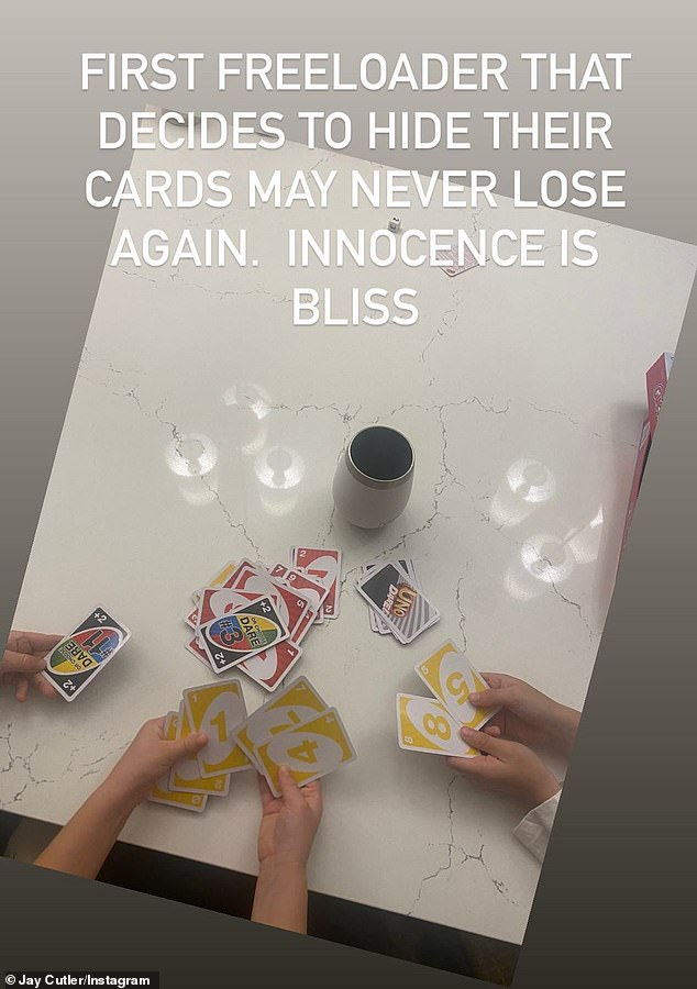 Fun and games: Cutler showed a photo of kids hands as they played Uno as he seemingly celebrated with the former pairs three children