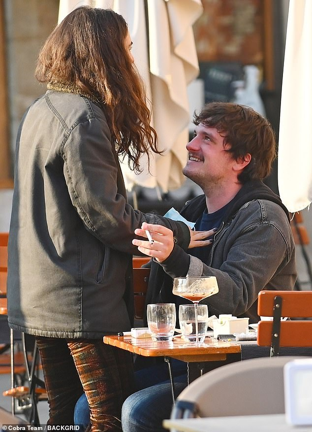 Staying tight: Traisac appeared to move closer to her boyfriend as they finished their meal