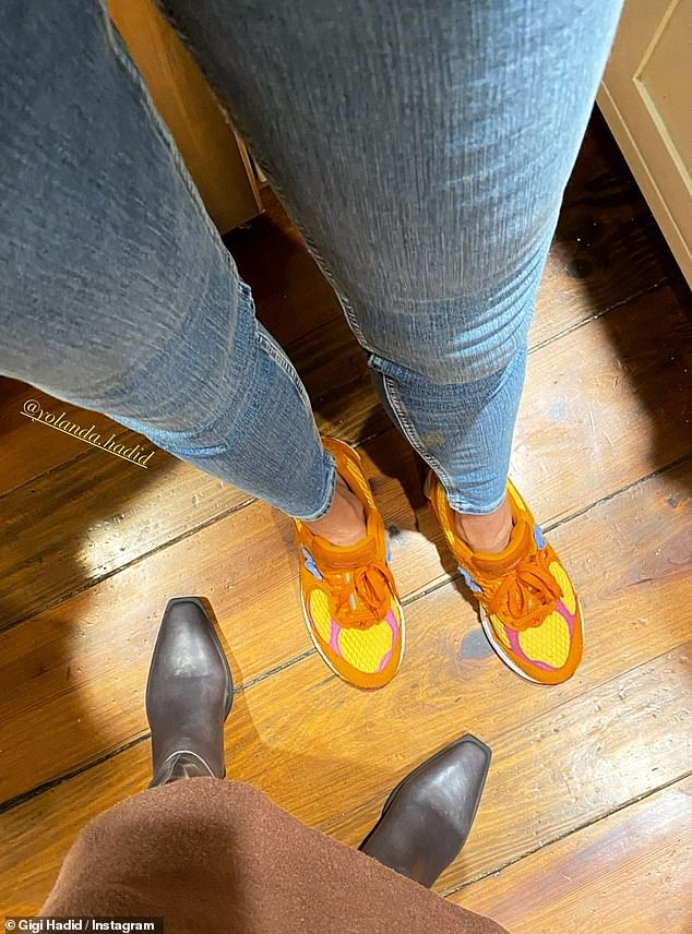Mother and daughter: The model started things off with a snap in square-toed boots next to her mother Yolanda Hadid's, in funky yellow and orange sneakers