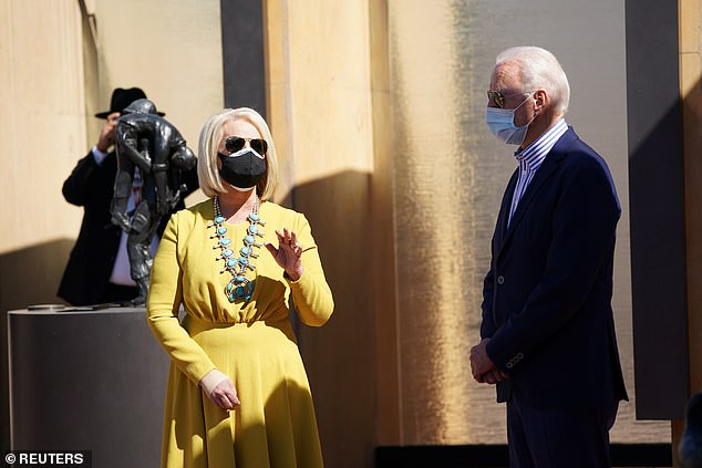 Cindy McCain (left), 66, the widow of the late Senator John McCain, is reported to be the frontrunner for the post of US ambassador to the United Kingdom under incoming President-elect Joe Biden. Biden is seen right with Cindy McCain in Phoenix, Arizona, on October 8