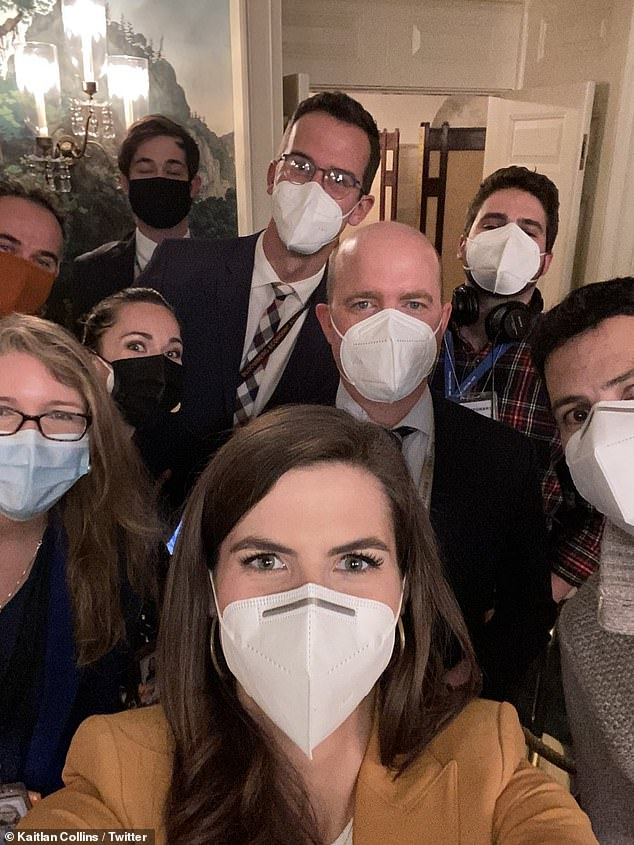 Collins captioned the photo: 'The crew that got President Trump to answer his first questions in over three weeks.  Proud to be part of it.  Happy Thanksgiving! '