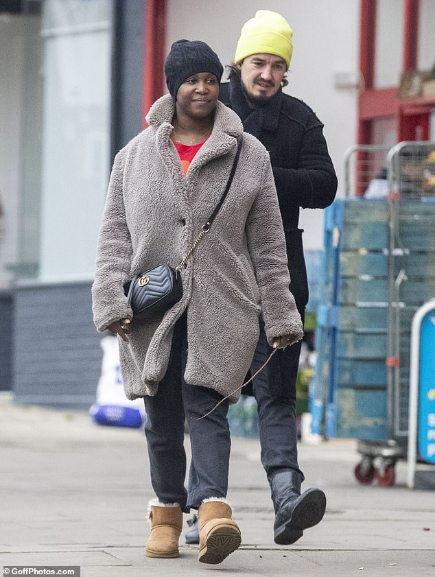 Casual:Motsi also sported a black cable knit beanie hat, while appearing to go make-up free as she flaunted her radiant complexion