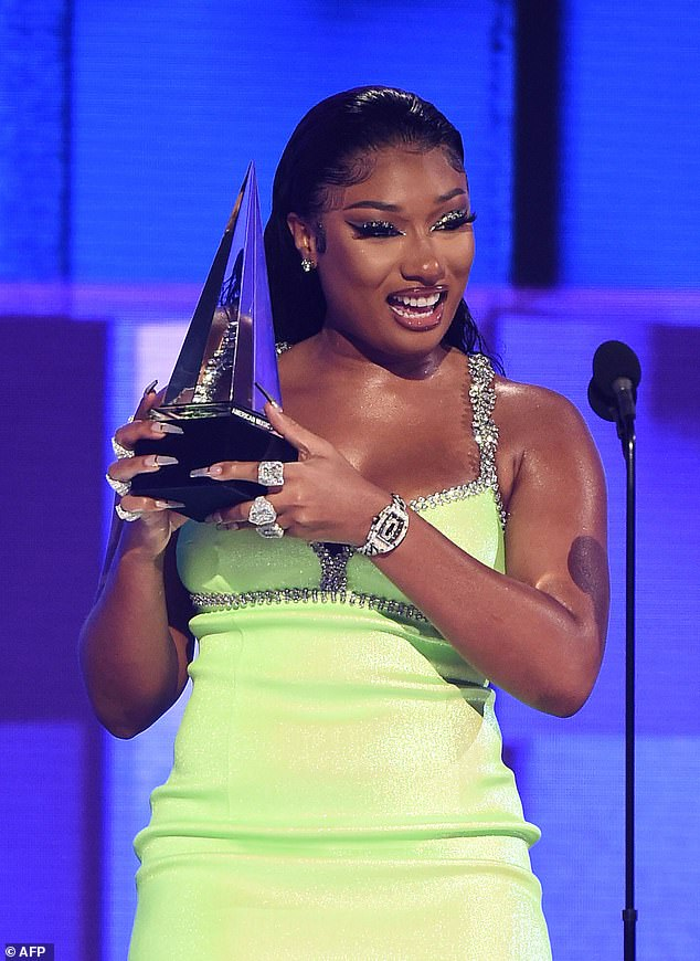 Bright future:Megan had a big year including a recent American Music Award for Favorite Song Rap/Hip-hop as well as a People's Choice Award for Favorite Collaboration Song for WAP and has garnered four Grammy nominations; pictured at the 2020 AMAs