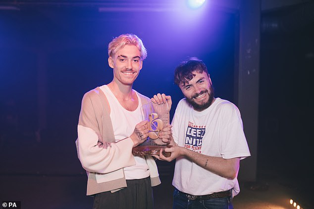 Pop: HYYTS are pictured holding their award, which they took for the Best Pop Act Award