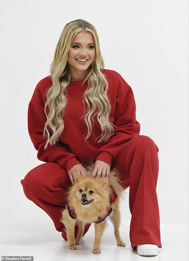 Love Island's Molly Smith looks festive in red loungewear as she larks around with Pomeranian Nelly