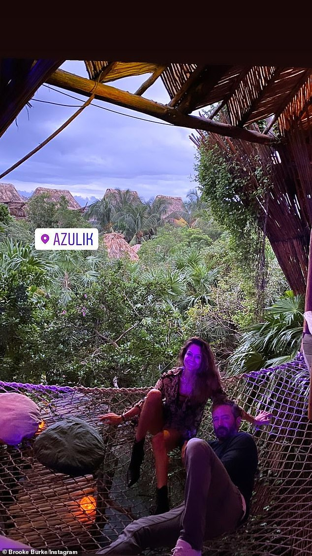 Romance: Later that evening, the couple caught the sunset while nestled in the jungle from the top of the Azulik Resort