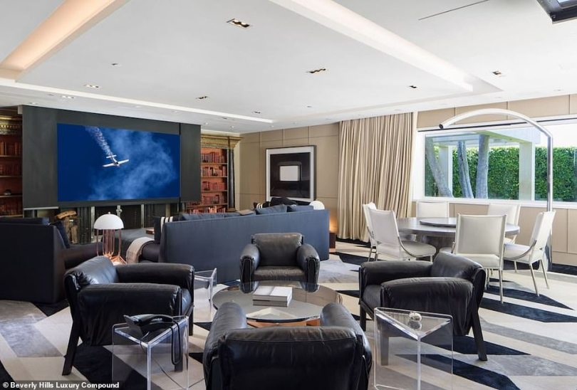 Where meetings take place: A power meeting area has two tables and a mini living room with a wide screen TV