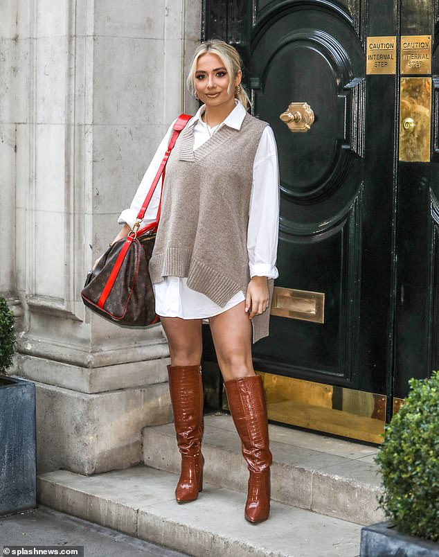 Fashion: Saffron Barker cut a very stylish figure in a mini skirt and oversized knitted cardigan as she headed to BBC Morning Live in London on Monday.
