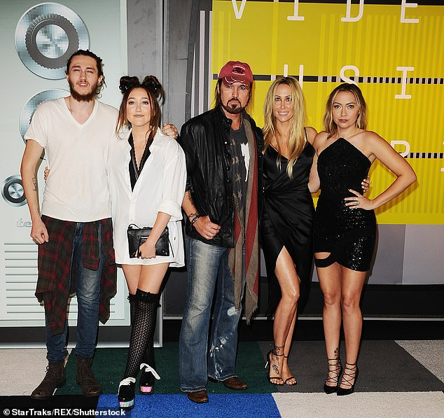 Squad:The pop star, 28, spoke about a typical Christmas in the Cyrus household during an appearance on KISS Breakfast Show earlier this month (Pictured L-R Braison, Noah, Billy, Tish and Brandi)