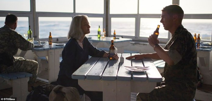 "Hollander and Couch meet for a beer at a seaside bar. Hollander says, ""I'm not just defending him.  I defend the rule of law.  Couch responds, `` You haven't seen what I saw ''"