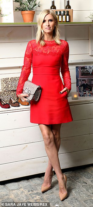 Nicky, 37, looked stylish in a red mini dress with semi-sheer patterned long sleeves