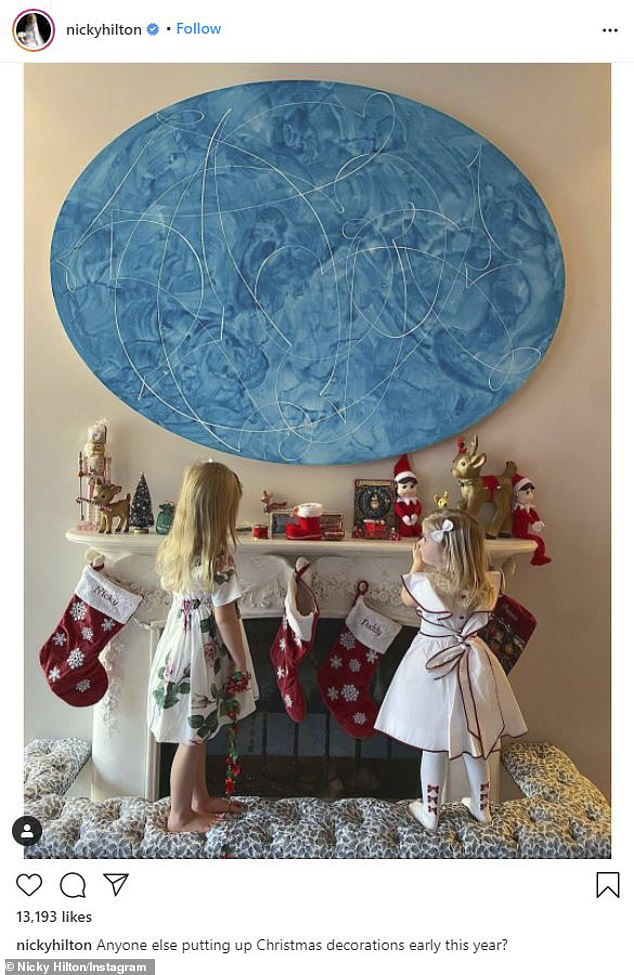 Mom: Nicky, who is married to banker James Rothschild, posted a sweet photo to Instagram showing daughters Lily-Grace and Teddy inspecting Christmas ornaments on a mantel piece