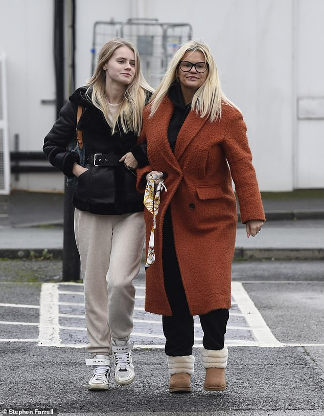 Family: The mother-of-five linked arms with Lily-Sue, who was dressed in a co-ordinating cream tracksuit with a black shearling jacket, belted at the waist