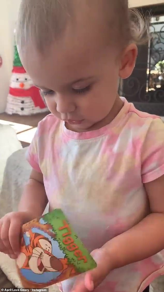 Bonding:Earlier in the day, April shared cute videos of Lola trying to play a Winnie the Pooh card game