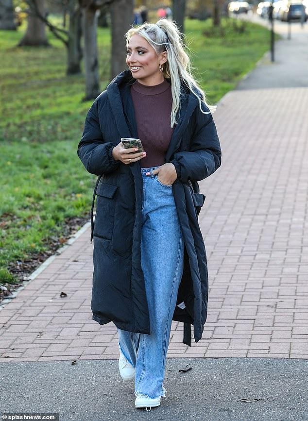 Looking good: Saffron looked sensational as she enjoyed a crisp park walk