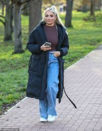 Saffron Barker nails casual chic in a navy quilted coat and flared jeans