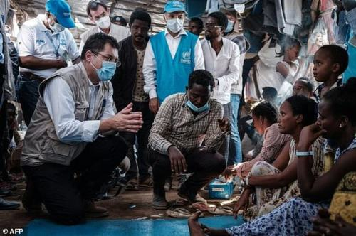 The European Union's crisis management commissioner Janez Lenarcic (L) met with Ethiopian refugees during a visit to the Um Raquba reception camp in eastern Sudan
