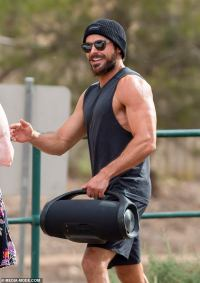 Zac Efron, 33, flaunts his VERY bulging biceps during a gym session South Australia