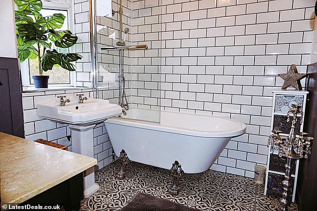 AFTER: A stunning bathroom with subway tiles and a roll-top bath was put in by Deborah and Paul during one of their home renovation projects in Yorkshire