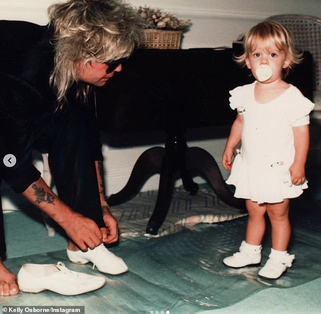 Father and daughter: One of the old snaps showed Ozzy with a barnet of blonde locks wearing a pair of shares, while little Kelly blew a bubble of bubblegum