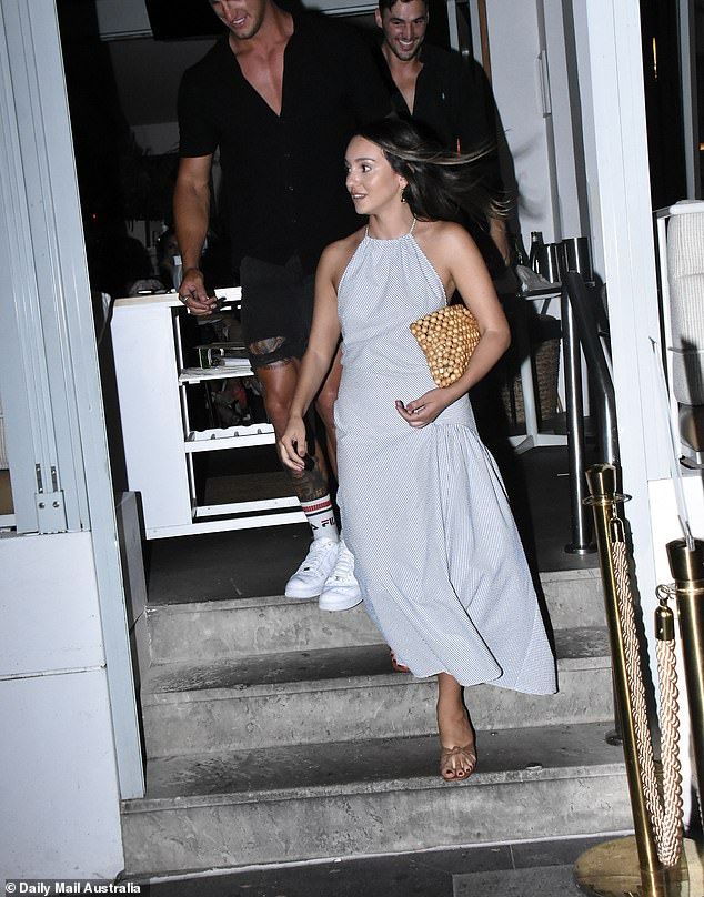 Stunner:Bella Varelis looked ecstatic to be single on Friday, as she enjoyed a wild night out in Sydney's Double Bay with a whole heap of Bachie stars