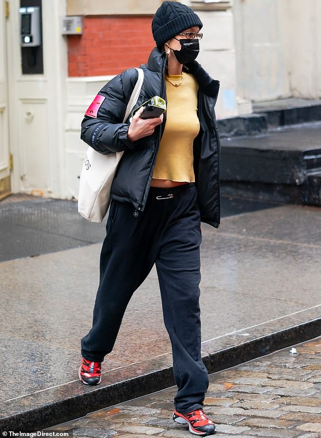 On the go:The sizzling sensation was glimpsed this Saturday emerging from lockdown in New York in an ultra-casual ensemble