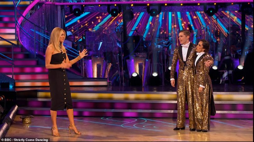 Sparkling: The duo donned matching sequinned suits for their costumes (pictured with a glam Tess Daly)