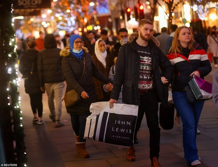 In the first non-working day since the lockdown ended on December 2, shoppers were pictured carrying bags of merchandise and waiting in queues outside stores, including Primark and the on-point Debenhams to close.