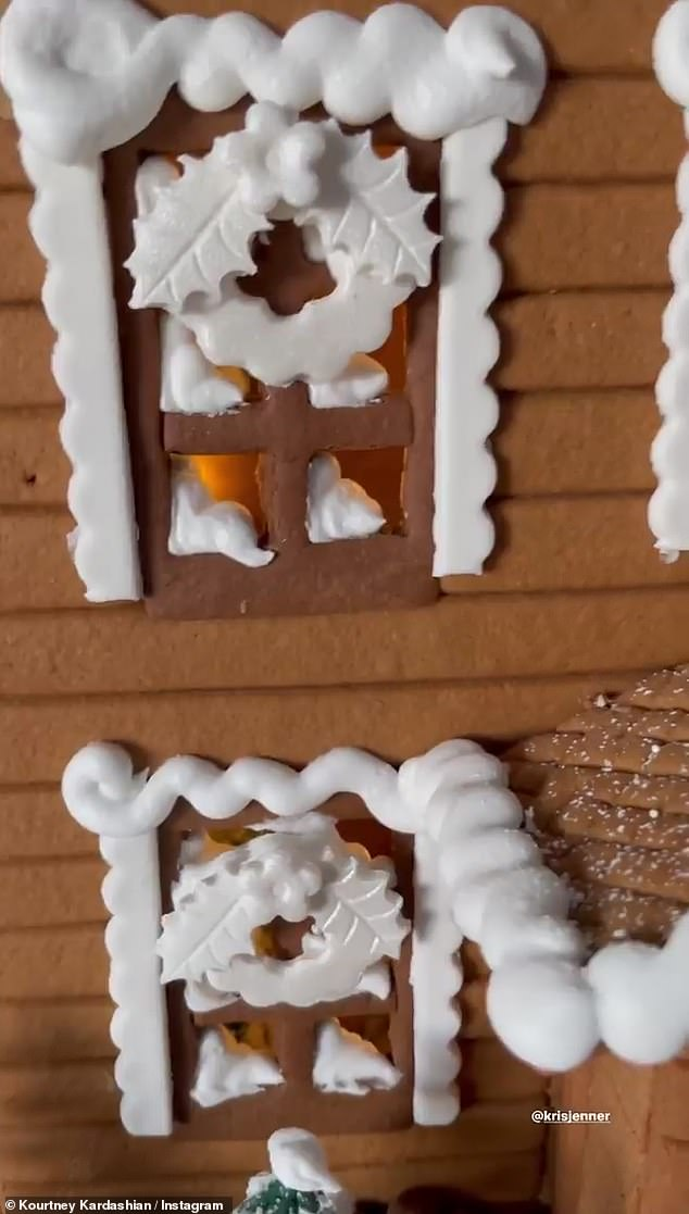 Decorations galore:Each of the windows were dressed with icing wreaths and each gingerbread person had a scarf, three buttons, and an icing expression