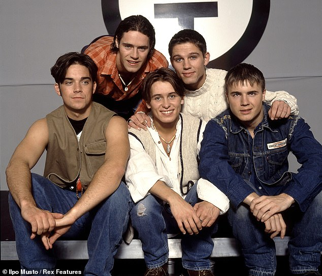 Insecurity: Robbie said he believed his insecurities dated back to his time in the Take That boyband (pictured in 1993)