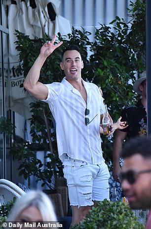 Strike a pose! The Bachelorette stars Nick Chamberlain (pictured) and Trent Cray appeared to be in good spirits as they hammed it up for the paparazzi