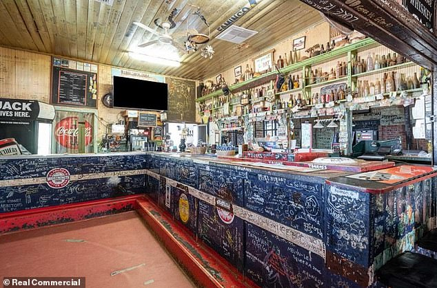 The pub (pictured) still maintains its rugged 120-year charm and has become a popular watering hole for tourists, miners and motorbike riders