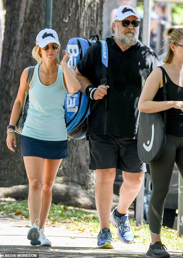 Love match: Russell Crowe, 56, and his rumoured girlfriend, Britney Theriot, 30, hit the court for a tennis match in Rushcutters Bay, Sydney, on Sunday
