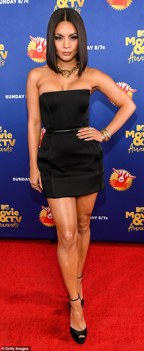 Figure flattering: Complete with a thin, waist cinching belt, the 31-year-old High School Musical alum's get-up did her fit physique justice