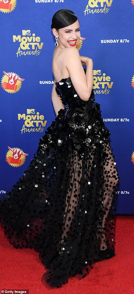 Wowzers: Sofia Carson wowed in a stunning ball gown that featured a sequin-covered bodice that steadily transformed into a polka-dot mesh moment