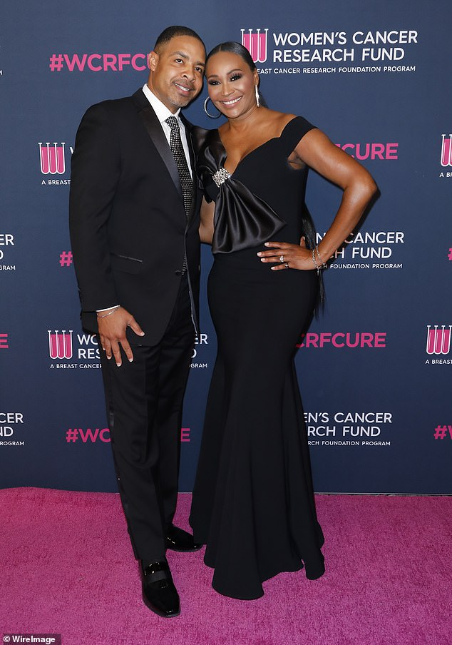 Pre-marital drama: Real Housewives of Atlanta's Cynthia Bailey, 53, and husband Mike Hill, 50, were at odds over the details of holding their October 10th wedding during the pandemic as Hill said, 'I don't give a f** about that wedding as long as I'm married to you'; pictured February 2020