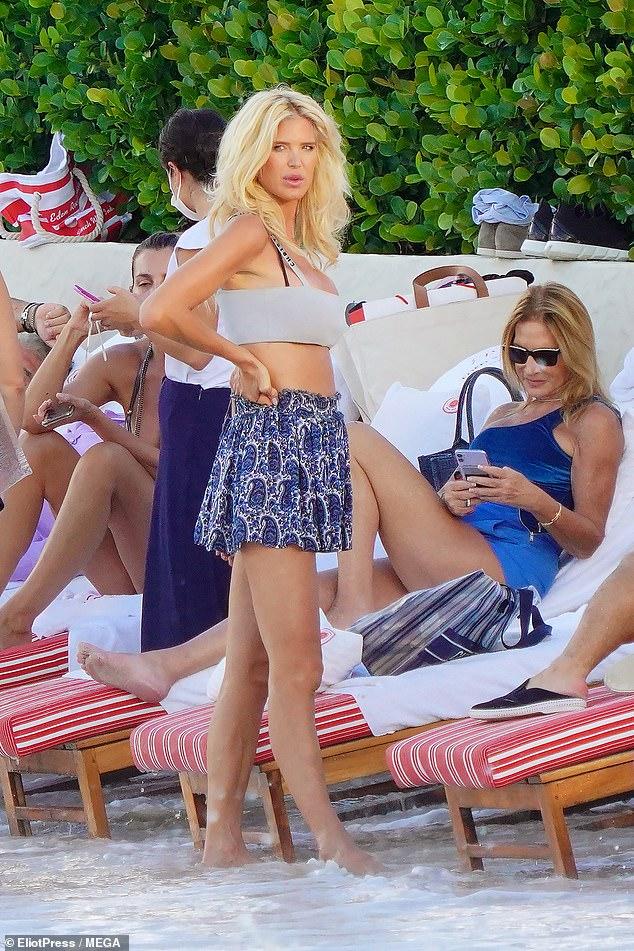Victoria Silvstedt, 46, showcases her tiny waist in a white bikini top