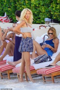 Victoria Silvstedt, 46, showcases her tiny waist in a white bikini top