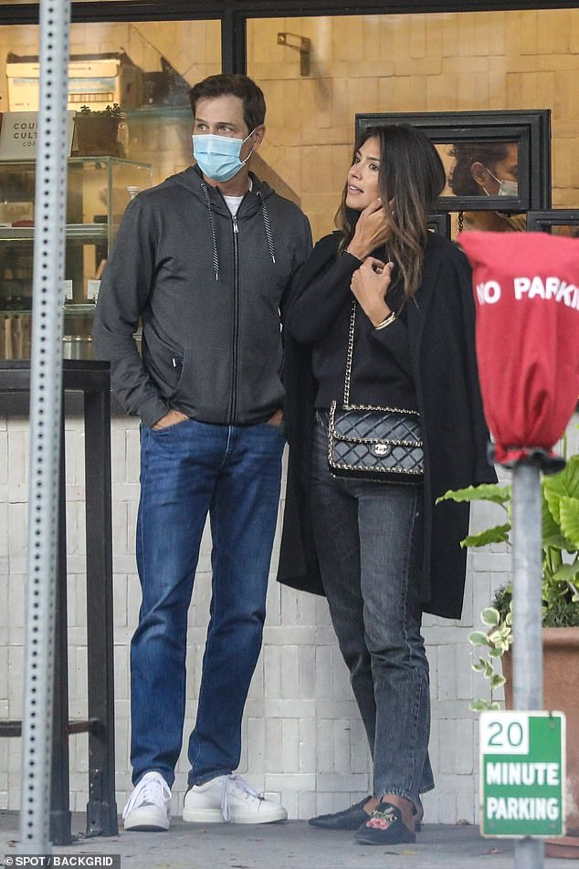 Engaged: Pia Miller and Patrick Whitesell looked loved-up when they stepped out in Los Angeles on Monday [both pictured]