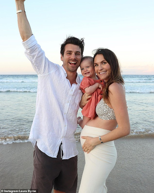 Baby love:Laura told Essential Baby that her fiancé is 'desperate' to find out if the pair are having a boy or girl, but she wants to keep it as a surprise. Pictured with Matty Johnson