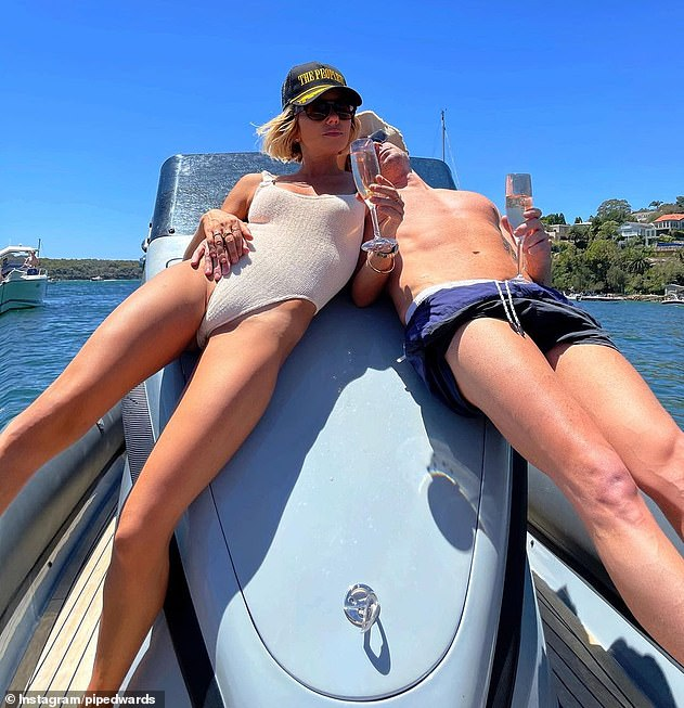 If you've got it, flaunt it! Pip and Michael reclining on Sydney Harbour for yet another cruise - this time on his $197,000 luxury inflatable