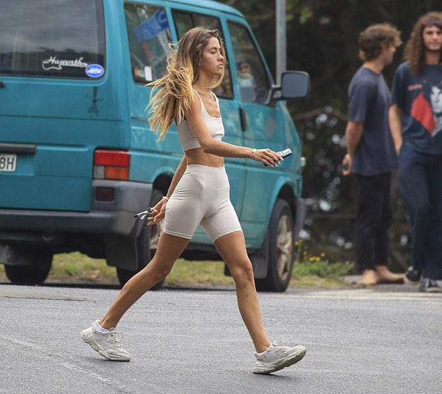 Tense: Influencer Ruby Tuesday Matthews appeared downcast while doing the lighthouse walk in Byron Bay on Tuesday - after losing her grandfather and beloved dog within days