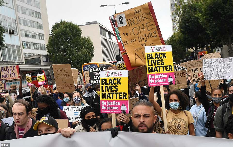 The BLM movement, which has snowballed in support in the wake of George Floyd's death, has been accused of straying beyond its anti-racism origins and becoming a brazen left-wing organisation. Pictured: Protesters in Notting Hill in west London on August 30