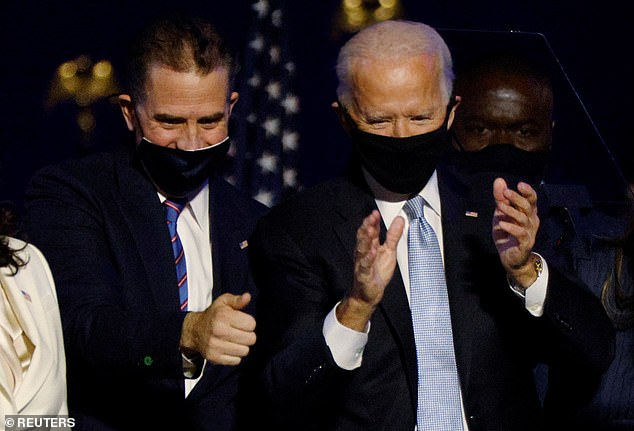 Hunter and Joe Biden are pictured at a celebration on the night Joe was declared the winner