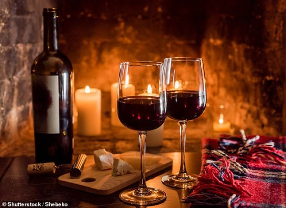 Eating cheese regularly, lamb once a week and enjoying a daily glass of red wine can help prevent age-related cognitive decline, a study concluded.  In the photo, cheese and wine