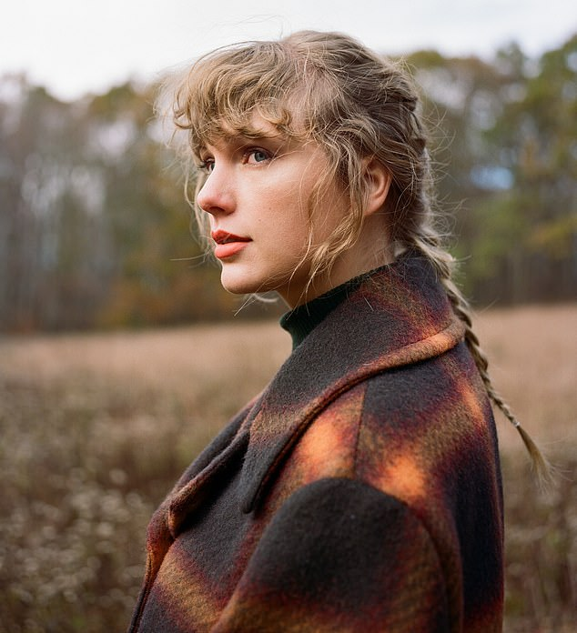 Taylor Swift fans think a hidden word in album artwork means she has a THIRD record on the way