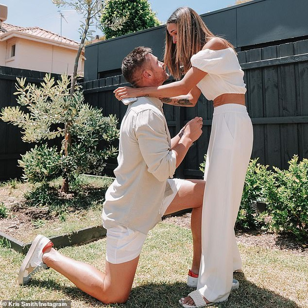 Surprise! Kris Smith (left) has announced his engagement to longterm partner Sarah Boulazeris (right). The model shared two photos of the moment he got down on one knee to his Instagram on Saturday