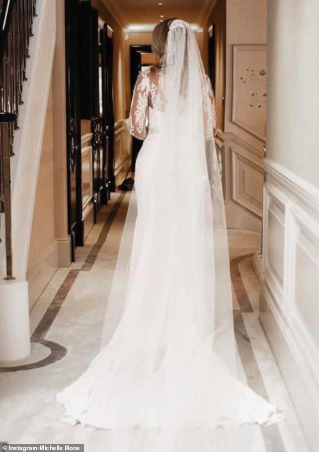 Newlywed: Michelle shared a snap of her dress from the back, which she said 'had a corseted beaded lace bodice with a fishtail crepe skirt and a beautiful matching hand-beaded lace veil'
